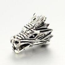 Antikolt ezüst színű sárkány fej alakú gyöngy (17x11mm)