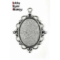 Antikolt ezüst színű díszített medálalap (30x40mm)