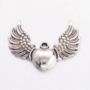 Antikolt ezüst színű szárnyas szív medál