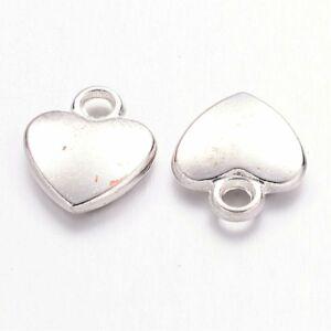 Antikolt ezüst színű pici szív fityegő
