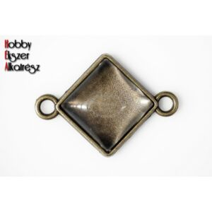 Antikolt bronz színű négyzetes kapcsolóelem hozzátartozó üveglencsével
