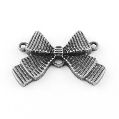 Antikolt ezüst színű masni alakú kapcsolóelem