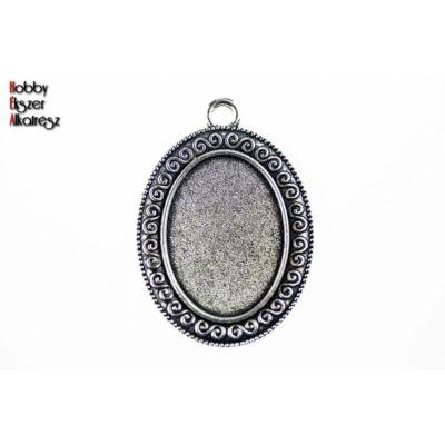 Antikolt ezüst színű csigavonalas medálalap (18x25mm)