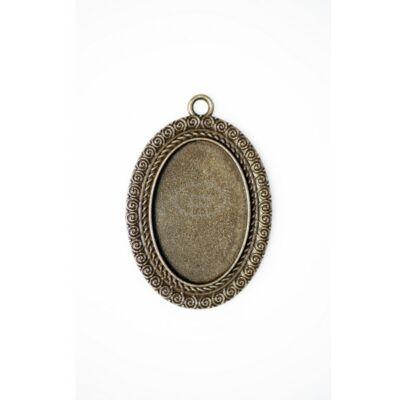 Antikolt bronz színű csigavonalas medál (20x30mm)