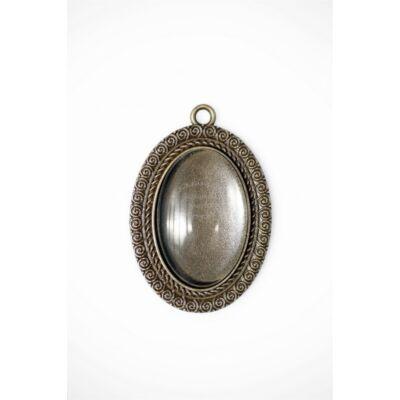Antikolt bronz színű csigavonalas medál (20x30mm) hozzátartozó üveglencsével
