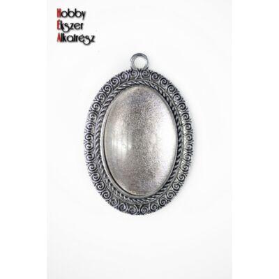 Antikolt ezüst színű csigavonalas medálalap (20x30mm) hozzátartozó üveglencsével