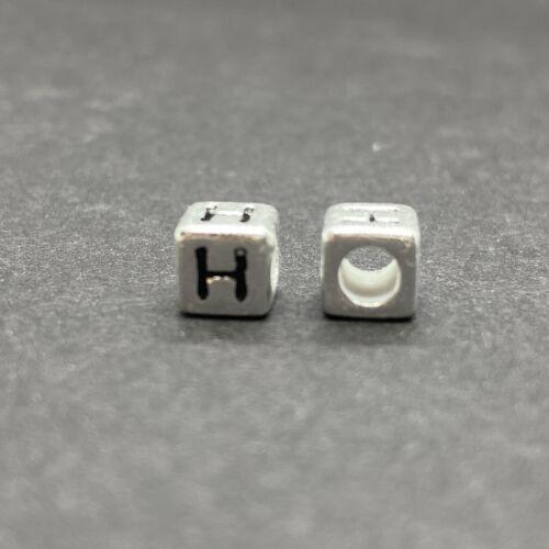 Műanyag ezüst színű h betűgyöngy (6mm)