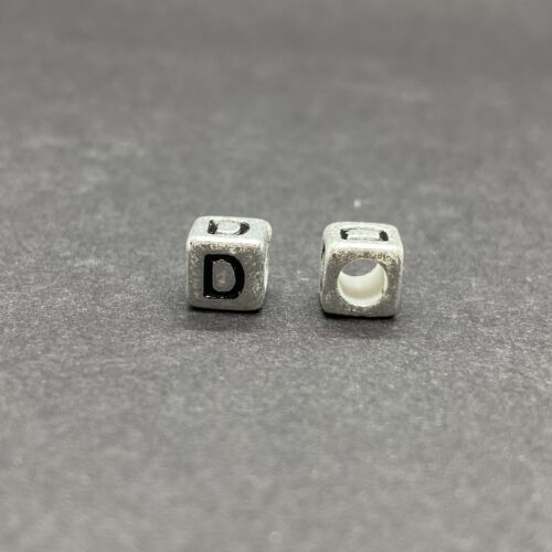 Műanyag ezüst színű d betűgyöngy (6mm)