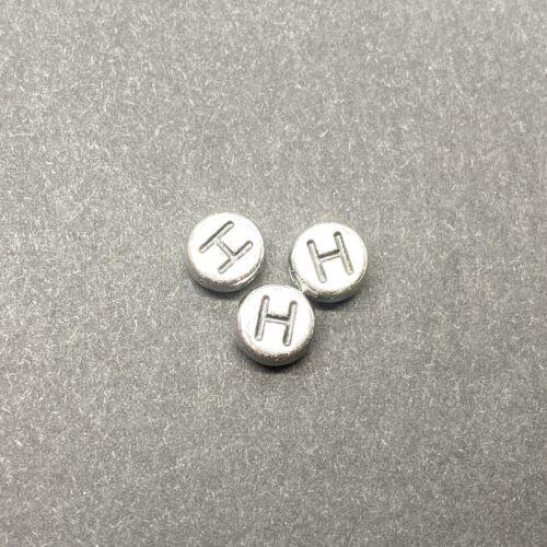 Műanyag ezüst színű kör h betűgyöngy (6mm)
