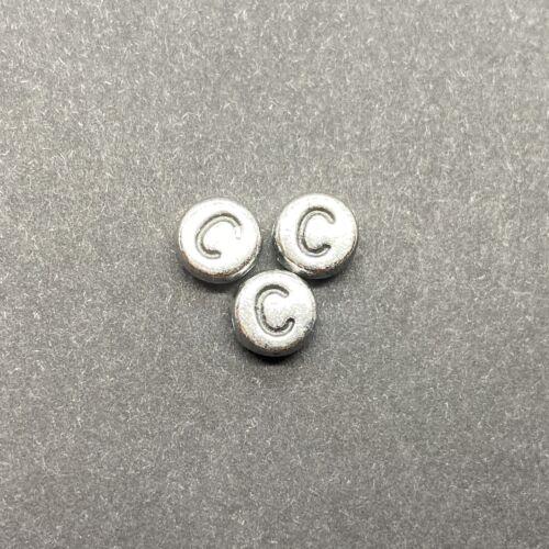 Műanyag ezüst színű kör c betűgyöngy (7mm)
