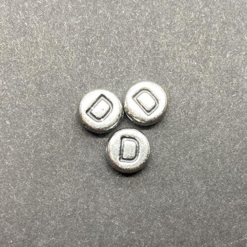 Műanyag ezüst színű kör d betűgyöngy (7mm)