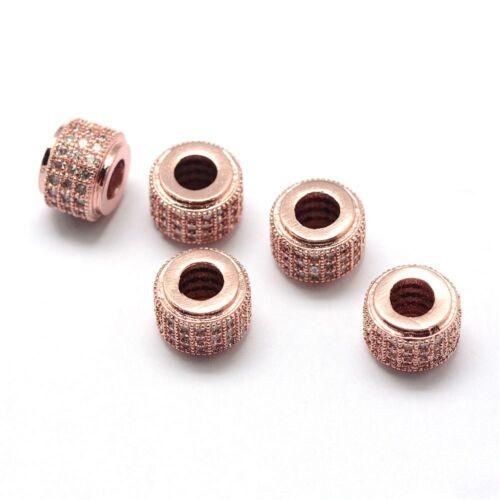 Strasszal díszített rozé arany színű cirkónia gyöngy (9x7mm)