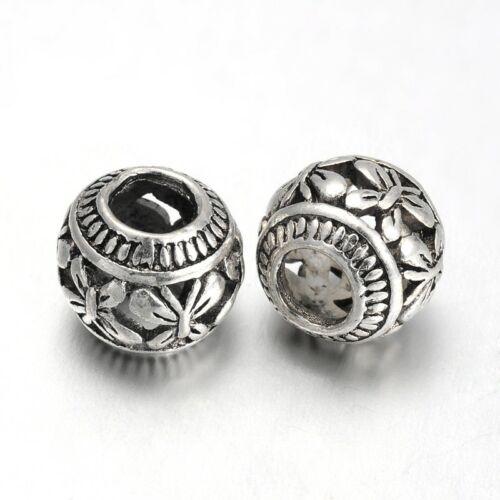 Antikolt ezüst színű pillangó mintás gyöngy (11x9mm)