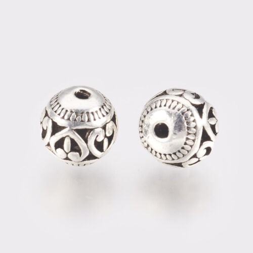 Antikolt ezüst színű szíves gyöngy (10x11mm)