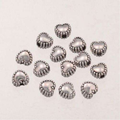 10db antikolt ezüst színű szív alakú köztes gyöngy (5,5mm)