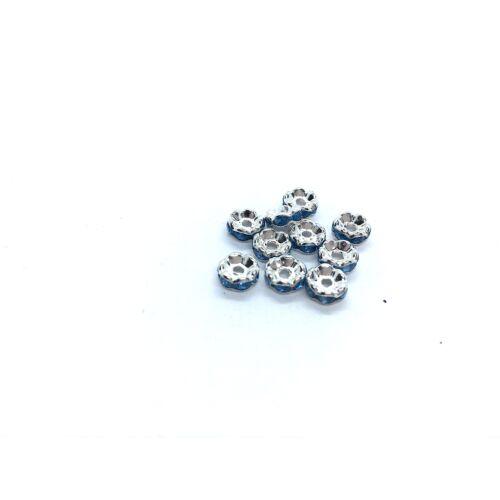 10db ezüst színű világos kék strasszos köztes (6x3mm)