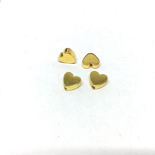 4db Arany színű szív alakú köztes gyöngy (5x6mm)