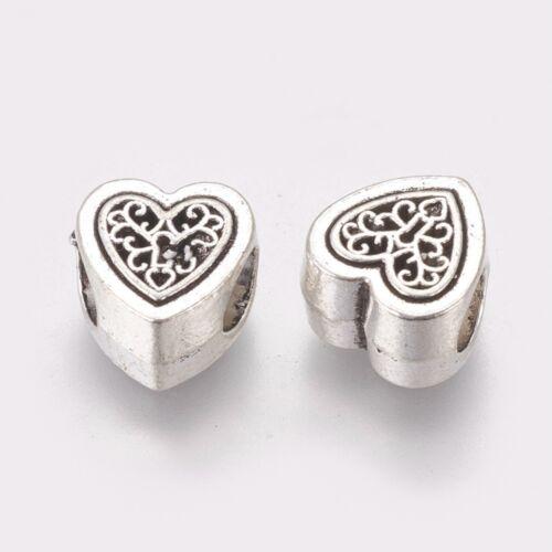 Antik ezüst színű szív alakú gyöngy (10x10,5x6mm)
