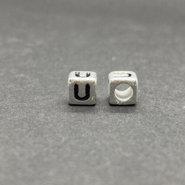 Műanyag ezüst színű u betűgyöngy (6mm)