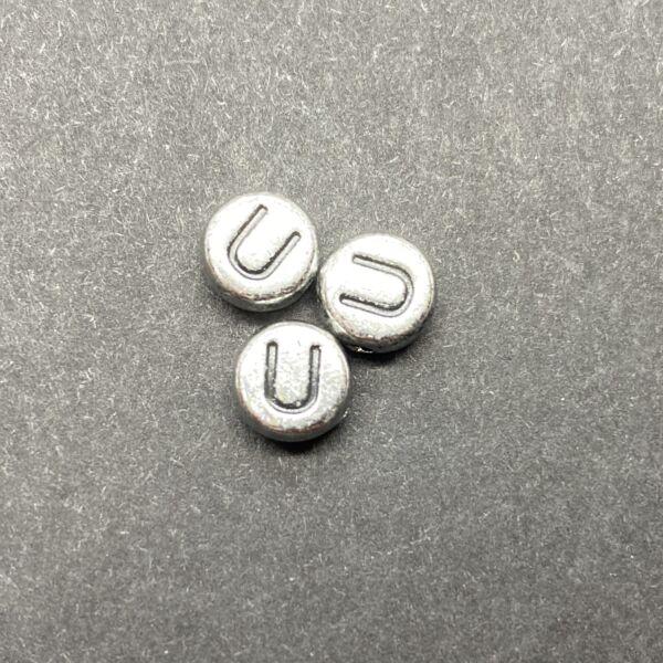 Műanyag ezüst színű kör u betűgyöngy (7mm)