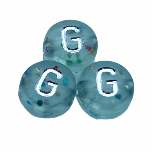 """Műanyag glitterrel díszített kör """"G"""" betűgyöngy (7mm)"""