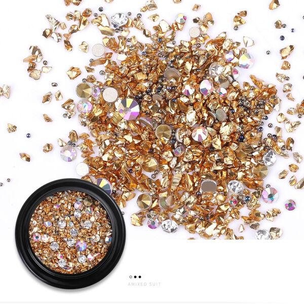 Arany színű strasszos díszítő elem dobozban