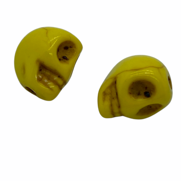 Szintetikus howlit sárga koponya gyöngy (9x7,5mm)