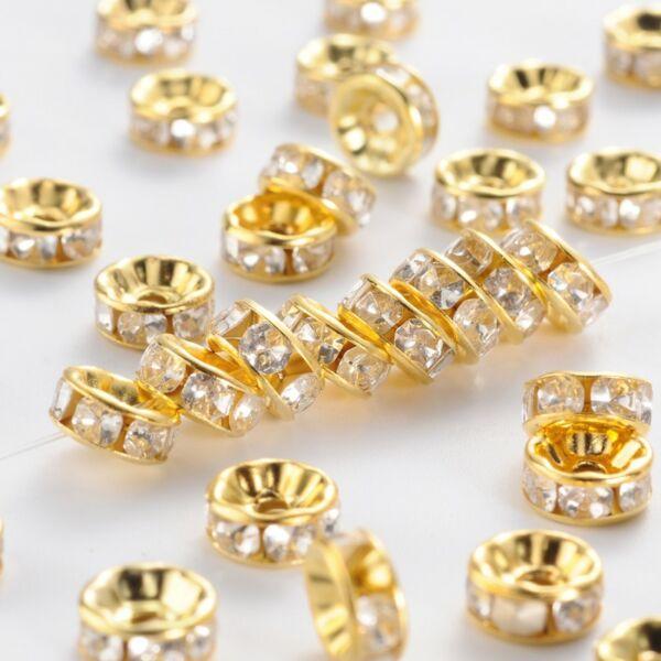 10db Világos arany színű strasszos köztes (6x3mm)