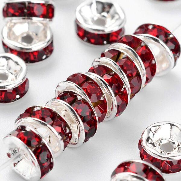 10db ezüst színű piros strasszos köztes (6x3mm)