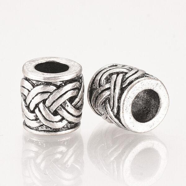 Antikolt ezüst színű fonott mintás gyöngy (10x9,5mm)