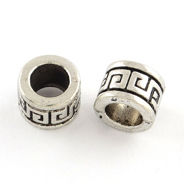 Antikolt ezüst színű csiga mintás gyöngy (9x7mm)