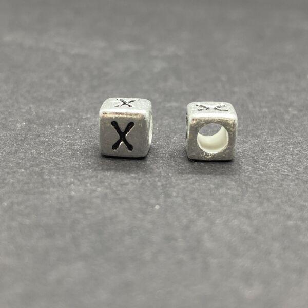 Műanyag ezüst színű x betűgyöngy (6mm)