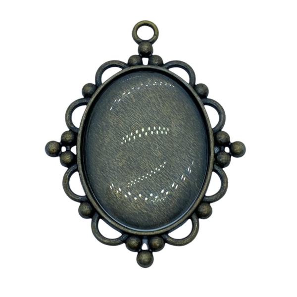 Antikolt bronz színű díszes medálalap (30x40mm) hozzá tartozó üveglencsével