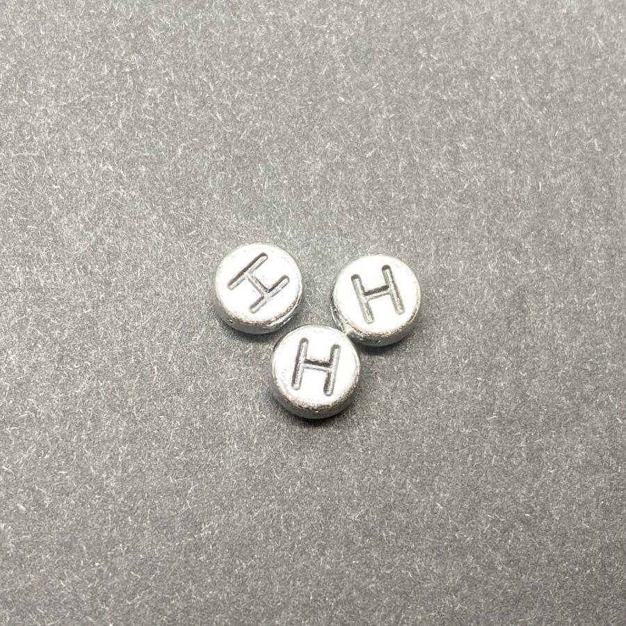 Műanyag ezüst színű kör h betűgyöngy (7mm)
