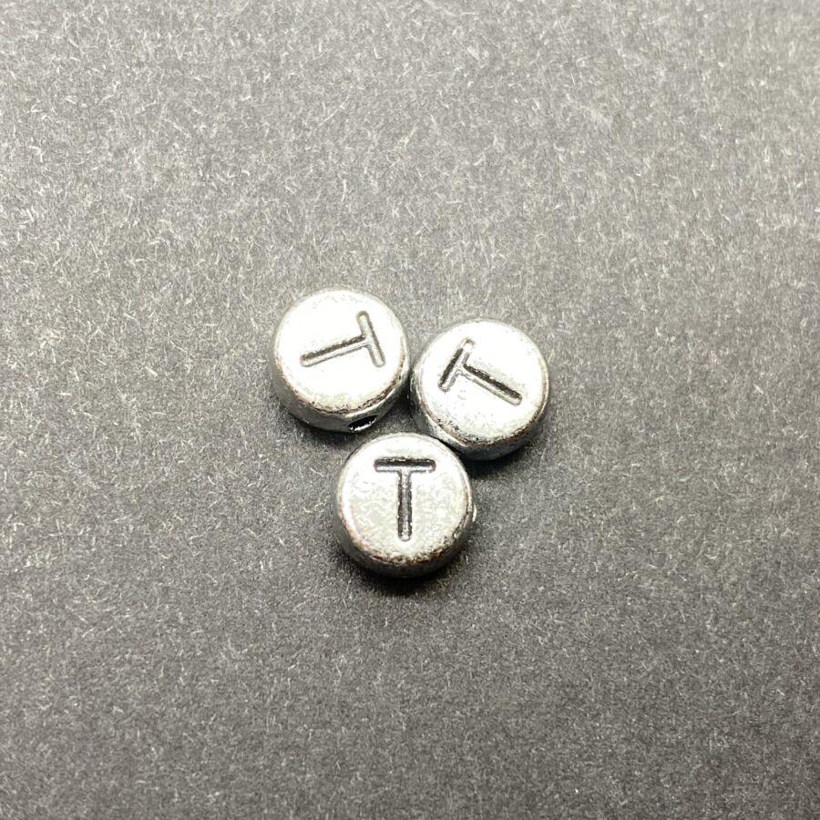 Műanyag ezüst színű kör t betűgyöngy (7mm)