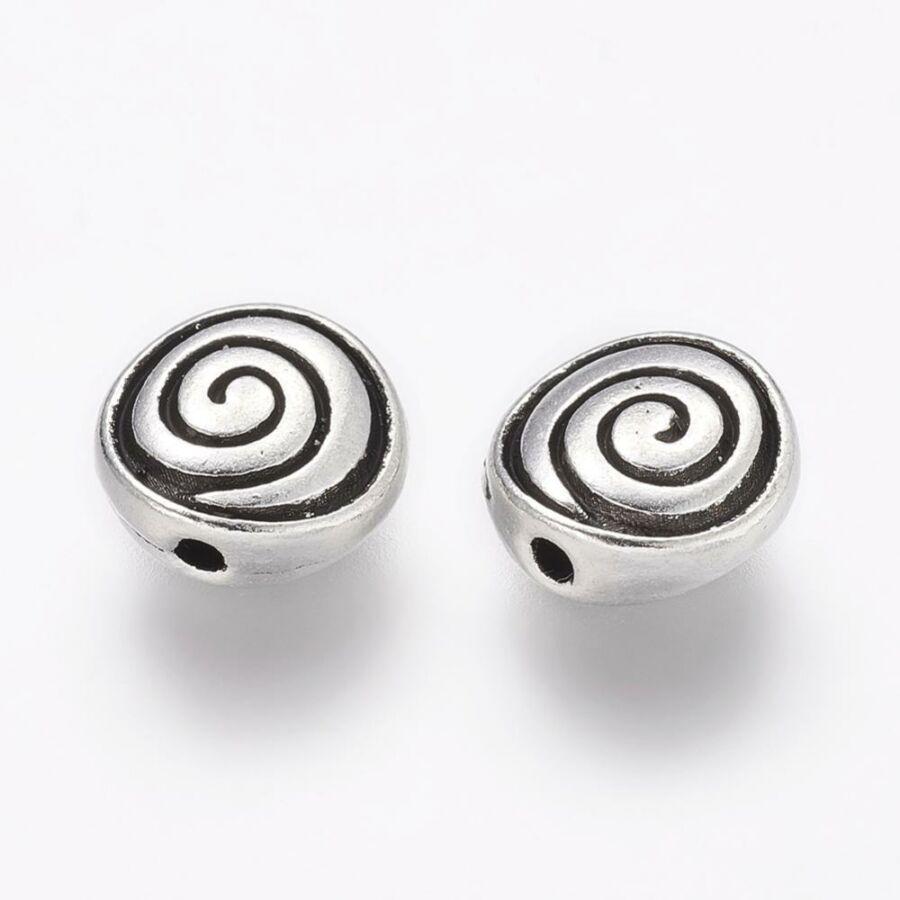 Antikolt ezüst színű csigavonalas  lapított gyöngy (8x4mm)